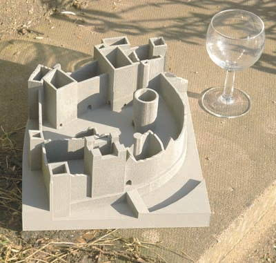 A grey scale model of part of Ludlow Castle shows its many towers and buildings enclosed within its high walls.